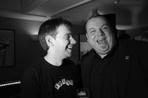 Black and white photograph of Walking Heads Dougal Perman with Jim Gellatly at the launch of Glasgow Music Tour