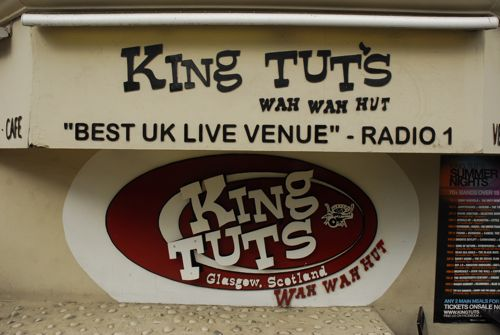 Sign in black and red outside King Tut's Wah Wah Hut in St Vincent Street