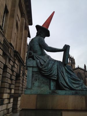 David Hume's statue, Royal Mile, wearing a traffic cone