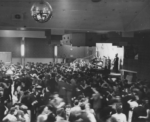 black and white photograph of dancing crowd