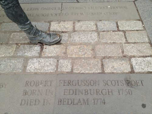 Foot of Robert Fergusson sculpture in Royal Mile