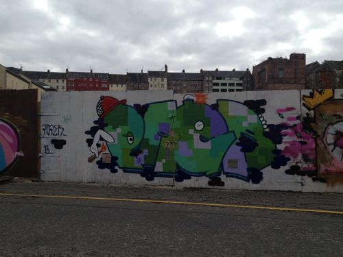 walking, view of graffiti on Calton Road