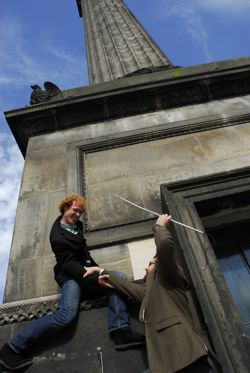Harry helps Jamie up the monument