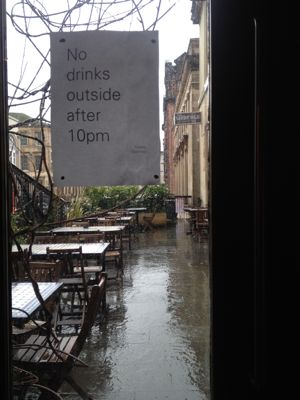 Wet patio outside Saramago Bar