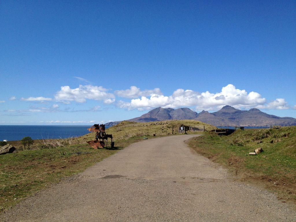 An open road under brilliant blue sky on the island of Eigg