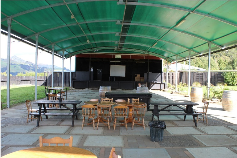 A view of the covered performance space at The Tavern