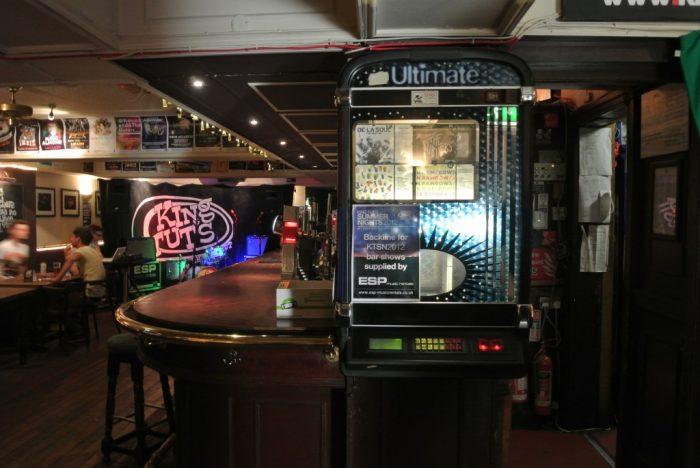 Inside King Tut's Wah Wah Hut, passing the famous jukebox