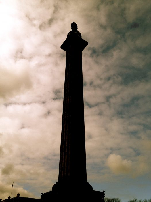 A silhouette of the Henry Dundas monument against an ominous sky