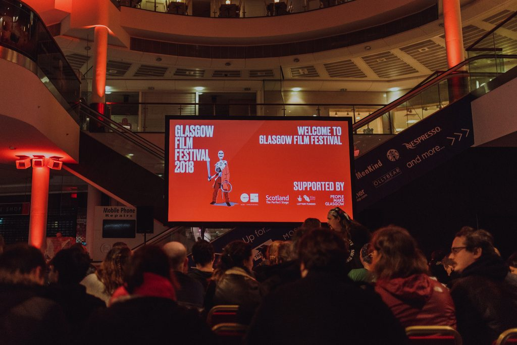 A packed audience ready for secret screening of Dawn of the Dead in Buchanan Galleries shopping centre: image Ingrid Mur for Glasgow Film Festival